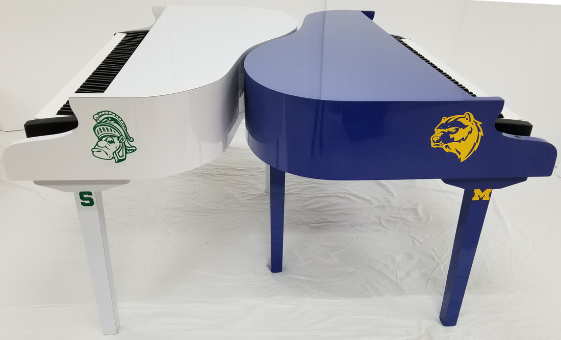 Michigan State University (MSU) sparty white piano vs University of Michigan (UofM) wolverines blue piano